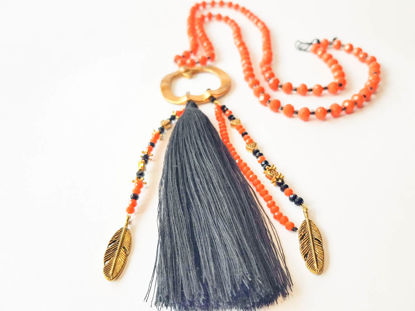 Picture of Beads Necklace with gold colored metal and big tassel ending. Handmade