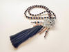 Picture of Woman's Necklace with beads silver colored metal crown and big tassel ending. Handmade