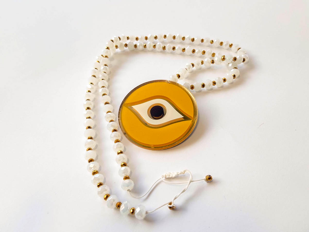 Picture of Woman's Necklace with beads and big glass eye Pendant. Handmade