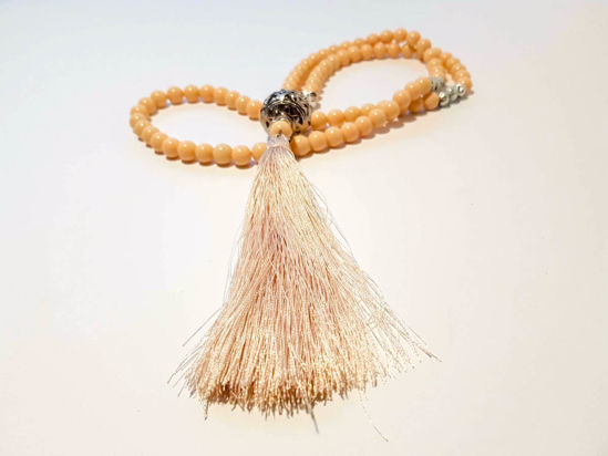 Picture of Woman's Necklace with onyx beads lava stones a metal element and big tassel ending. Handmade