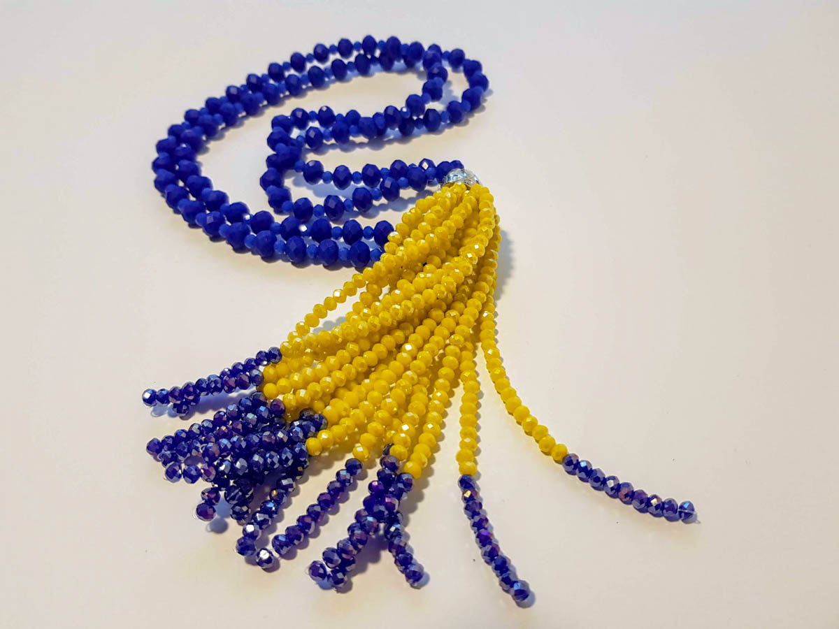 Picture of Woman's Necklace with beads  and big tassel made with beads. Handmade Blue
