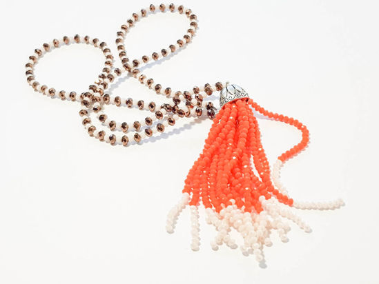 Picture of Woman's Necklace with beads  and big tassel made with beads. Handmade White and Dark Gold colored