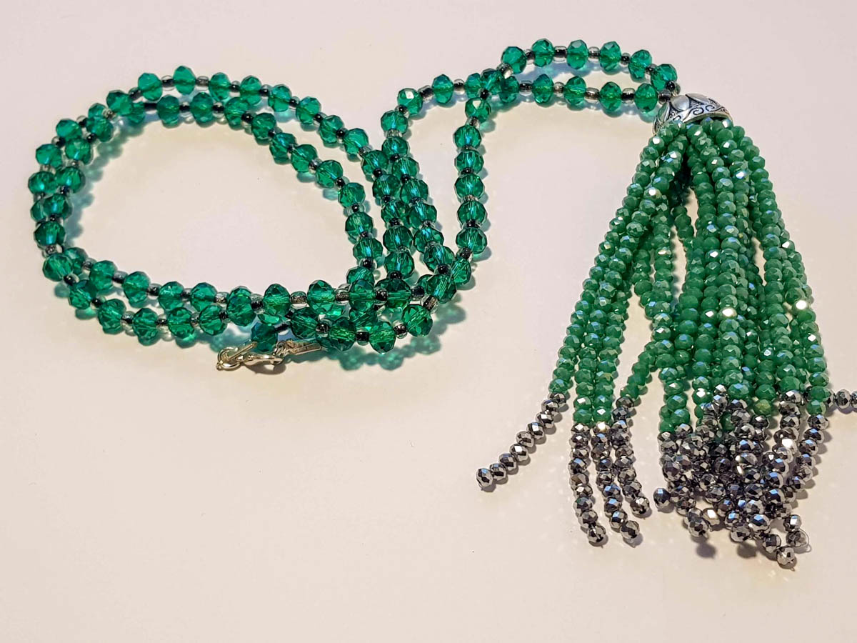 Picture of Woman's Necklace with beads  and big tassel made with beads. Handmade Green