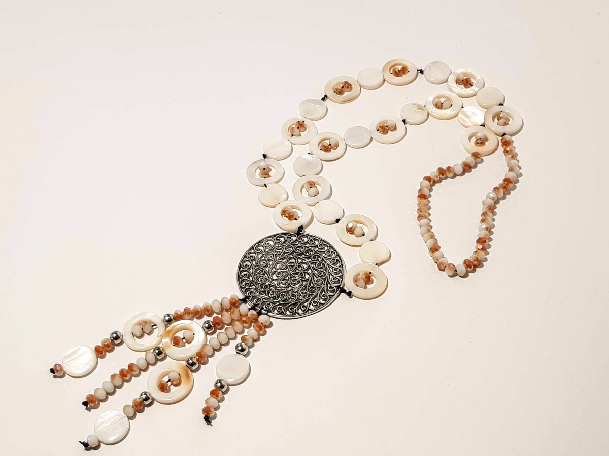 Picture of Woman's Necklace with crystal beads, ivory and big metal pedant. Handmade