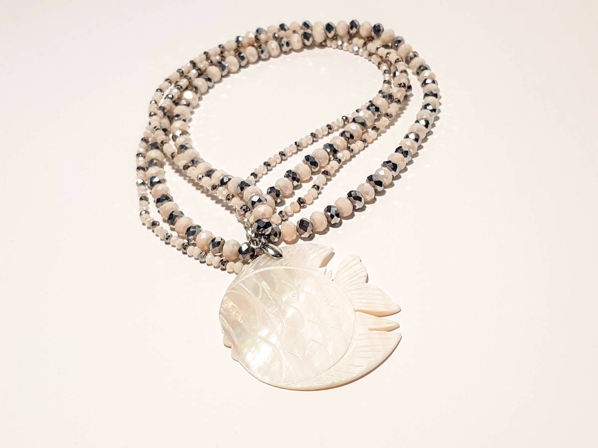 Picture of Woman's Necklace with crystal beads and big ivory fish Pendant. Handmade