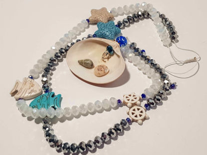 Picture of Woman's Necklace with crystal beads, lava stars, chaolite fishes and a big natural seashell . Handmade