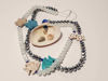 Εικόνα της Woman's Necklace with crystal beads, lava stars, chaolite fishes and a big natural seashell . Handmade