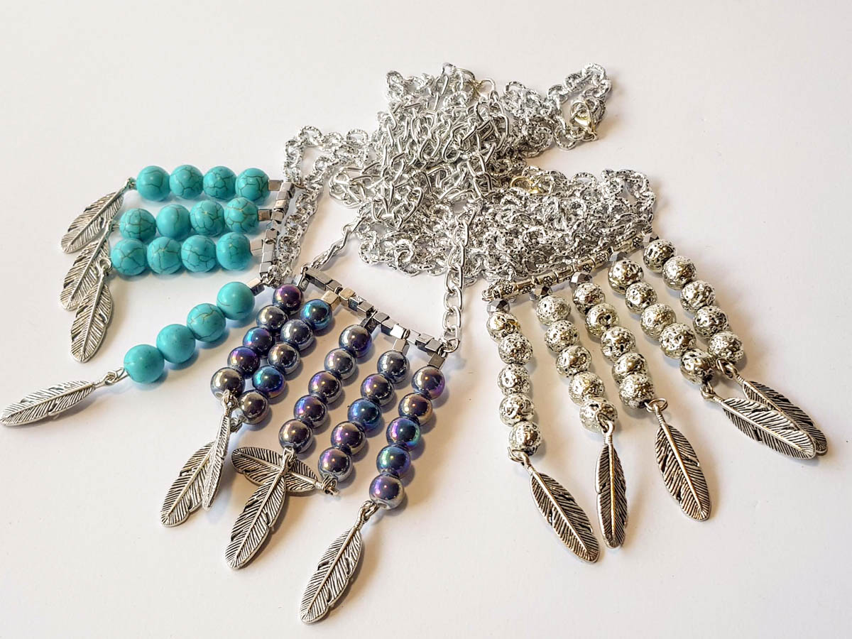 Picture of Woman's Necklace with 10mm chaolite or lava stone beads and metallic Indian feathers. Handmade.
