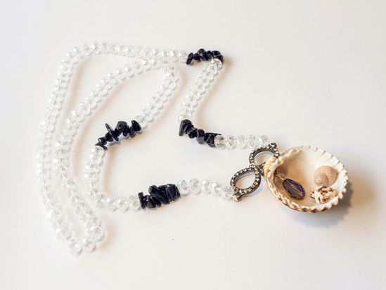 Picture of Woman's Necklace with crystal beads, black chips, metallic infinity element and a big natural seashell. Handmade.