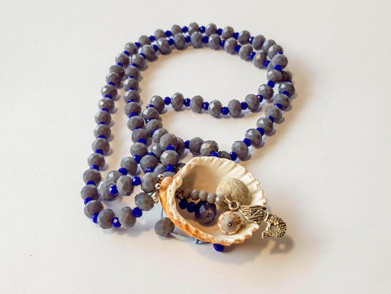 Picture of Woman's Necklace with crystal beads,  metallic elements and natural seashells. Handmade.