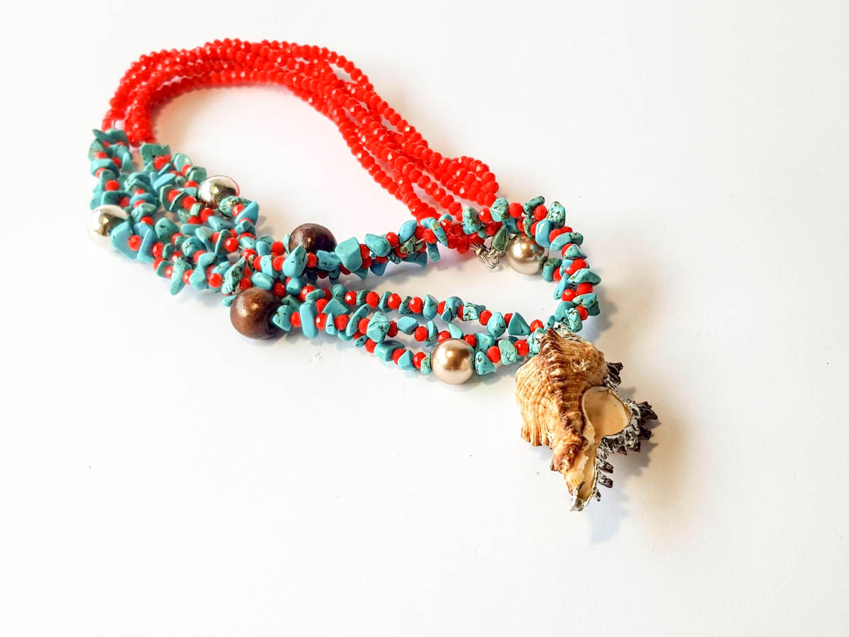 Picture of Woman's Necklace with crystal beads, chips, metallic and wooden balls and natural seashell. Handmade.