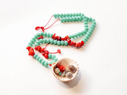 Picture of Woman's Necklace with crystal beads, chips, lava stones, metallic elements and natural seashell. Handmade.
