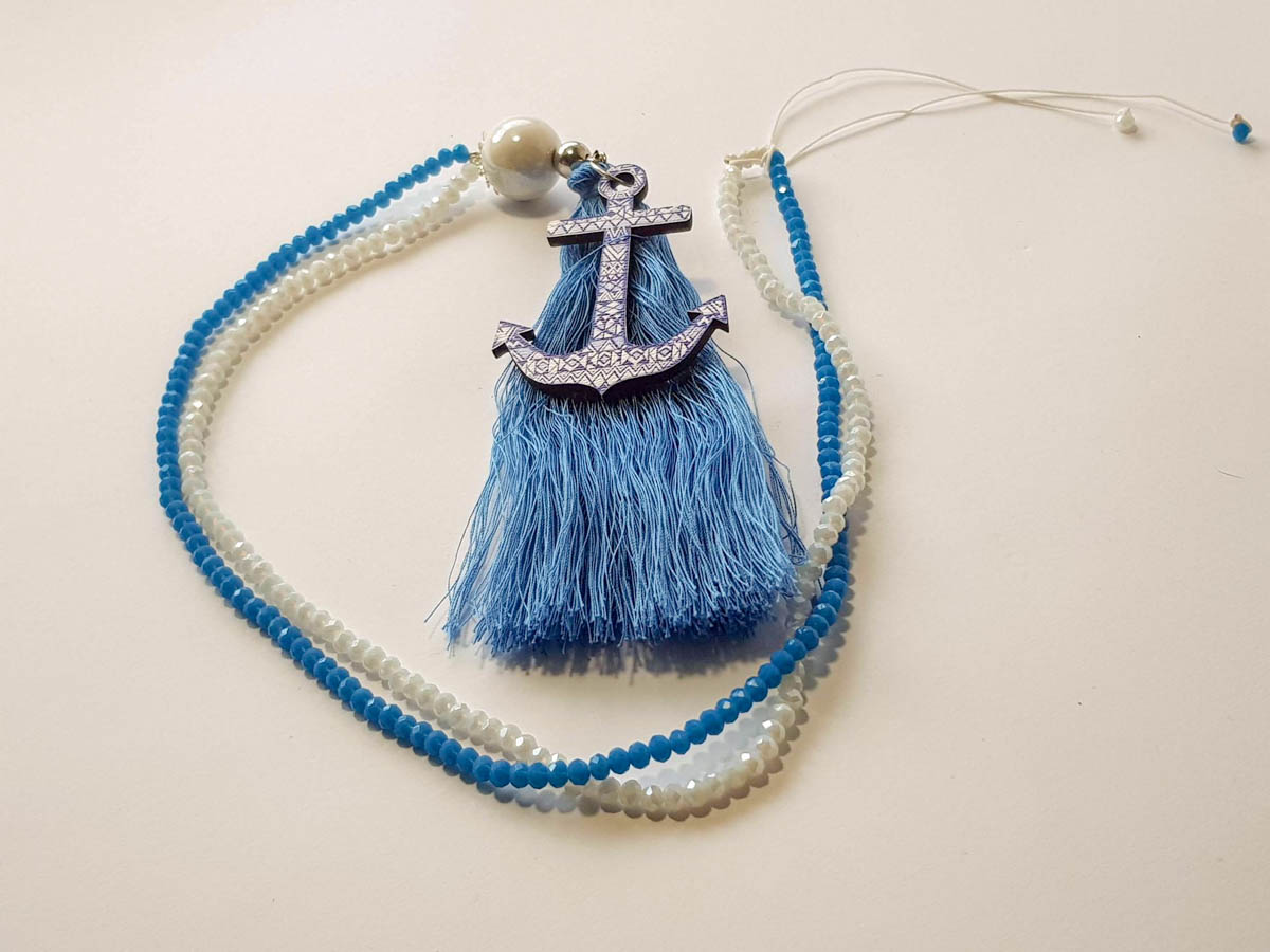 Picture of Woman's Necklace with Crystal Beads, big ceramic pearl, wooden anchor and a big tassel ending. Handmade
