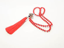 Picture of Woman's Necklace with red crystal beads, big metallic element and big red tassel ending. Handmade