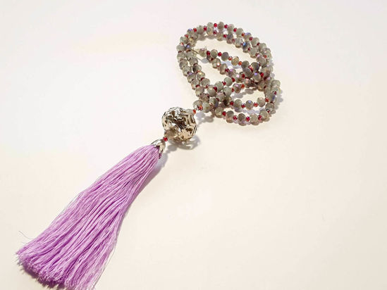 Picture of Woman's Necklace with grey crystal beads, big metallic element and a big lila tassel ending. Handmade
