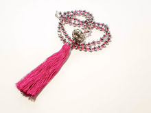 Picture of Woman's Necklace with a combination of silver and purple crystal beads, big metallic element and a big lila tassel ending. Handmade