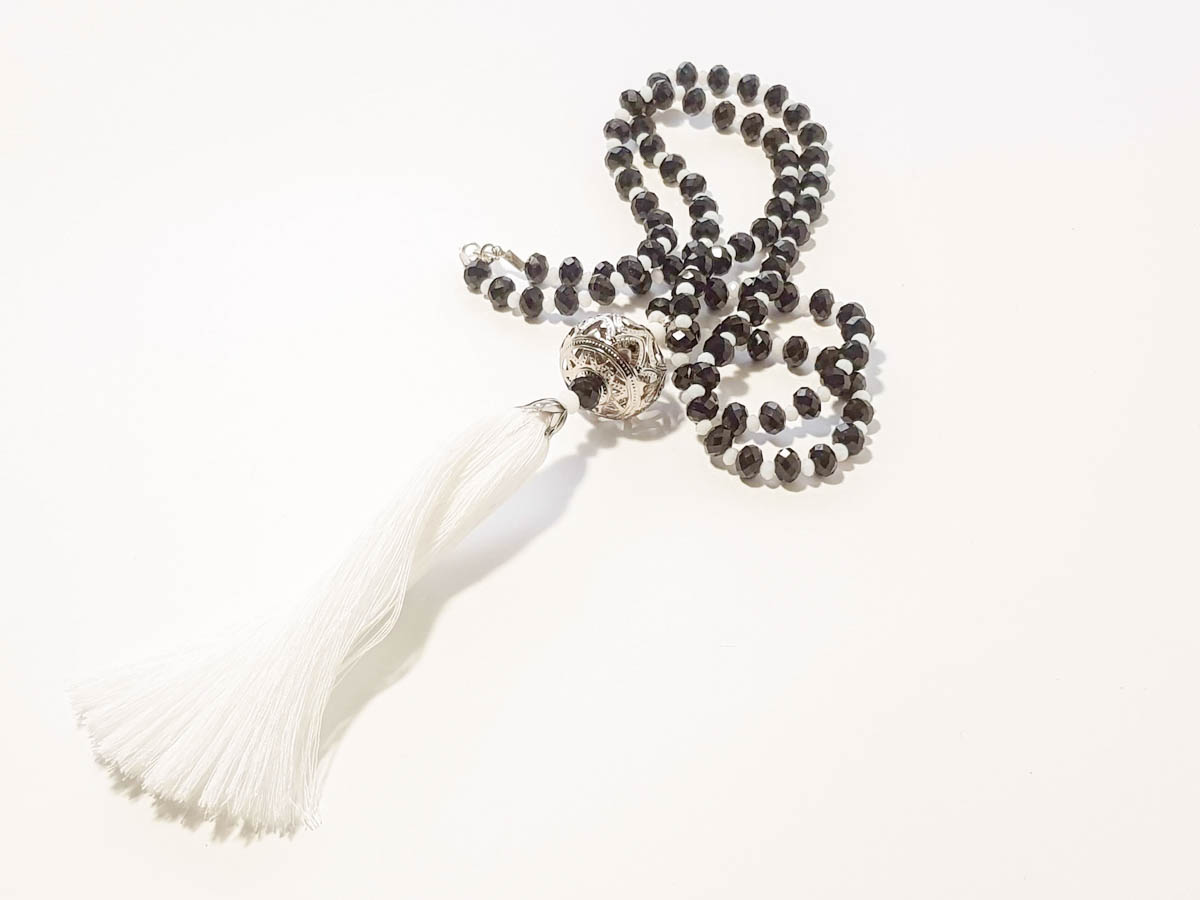 Picture of Woman's Necklace with a combination crystal beads, big metallic element and a big tassel ending. Handmade