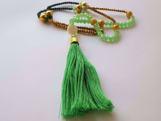 Εικόνα της Woman's Necklace with a combination  of green, graphite and  gold crystal beads,  metallic elements, 2 big ivory elements a big  and a big green tassel. Handmade