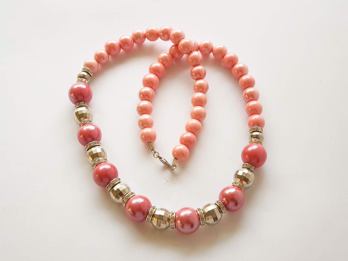 Picture of Woman's Necklace with ceramic beads, metallic colored plastic beads. Handmade Dark Pink