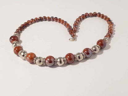 Picture of Woman's Necklace with ceramic beads, metallic colored plastic beads. Handmade  Brown