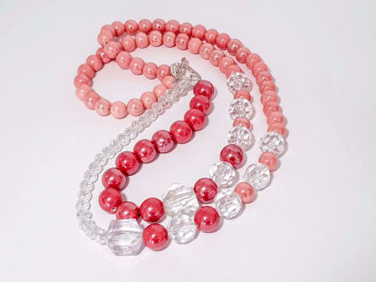 Picture of Woman's Necklace with a combination  of dark and light pink ceramic beads and various size transparent crystal beads. Handmade