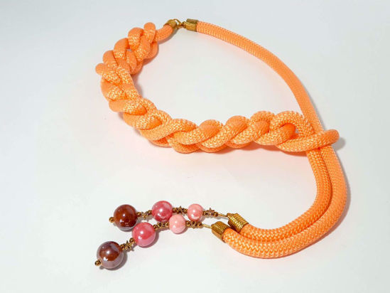 Picture of Woman's Necklace with orange synthetic cord and ceramic beads. Handmade.