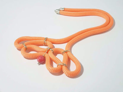 Picture of Woman's Necklace with orange synthetic cord and one big ceramic bead. Handmade.