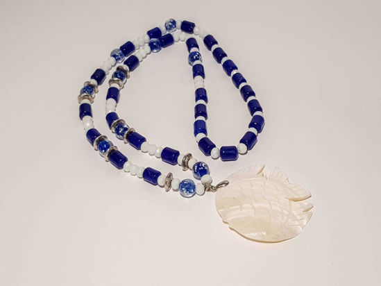 Picture of Woman's Necklace with a combination of white crystal beads, blue jade beads and murano type beads and a big ivory fish pendant  Handmade.