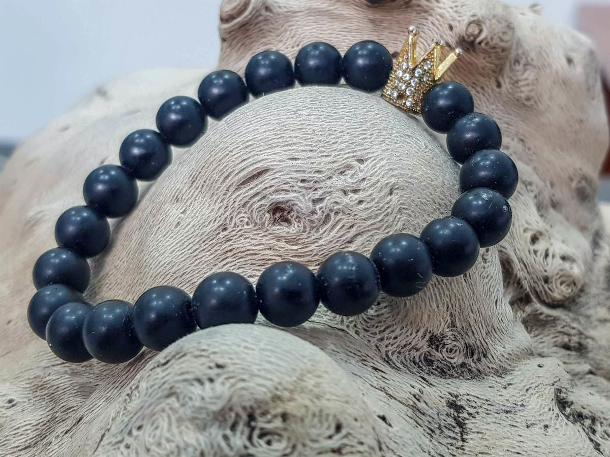 Picture of Men's  Bracelet with black stone beads and a beautiful crown. Handmade