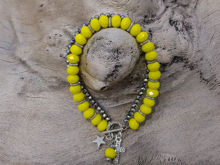 Picture of Woman's Bracelet with  two strings of crystal beads and metallic elements. Yellow Silver Handmade