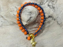 Picture of Woman's Bracelet with  two strings of crystal beads and metallic elements. Dark Orange Midnight Blue Handmade