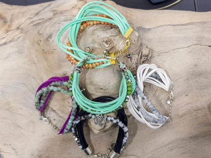 Picture of Woman's Bracelet with  strings of crystal beads and various colors suede strings.  Handmade