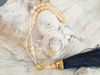 Picture of Greek Komboloi with natural stone gold colored metallic elements and big black tassel. Handmade