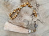 Picture of Greek Komboloi with jasper beads, silver colored metallic elements and big silk tassel. Handmade