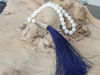 Picture of Greek Komboloi with synthetic pearl beads silver colored metallic elements and big blue silk tassel. Handmade