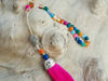 Picture of Greek Komboloi with colorful  semiprecious stone, silver colored metallic elements and big pink tassel. Handmade