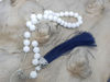 Picture of Greek Komboloi with onyx beads, silver colored metallic elements and big silk tassel. Handmade