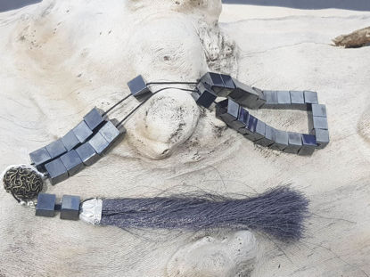Picture of Greek Komboloi with hematite beads, silver colored metallic elements and big silk tassel. Handmade