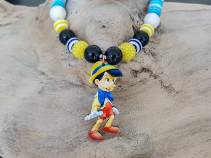Picture of Children's necklace and bracelet set made with big plastic beads and a big wooden Pinocchio figure  Handmade
